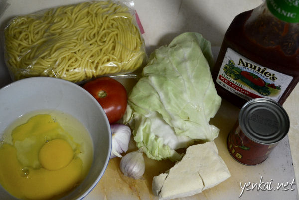 Basic ingredients for mee goreng - Eggs, beancurd, garlic, onion, tomato, cabbage or lettuce, tomato paste and ketchup (not shown here - light and dark soya sauce)